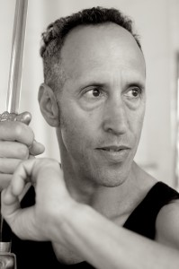 Joshua Grant, U.S. Gold Medalist Tai Chi, 2x U.S. National Champion in Wushu Tai Chi, and Founder of the Boston Kung Fu Tai Chi Institute shows a Tai Chi form holding a sword.